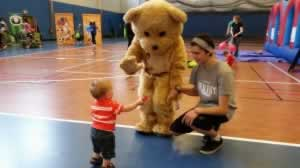 volunteer baby and bear waiving