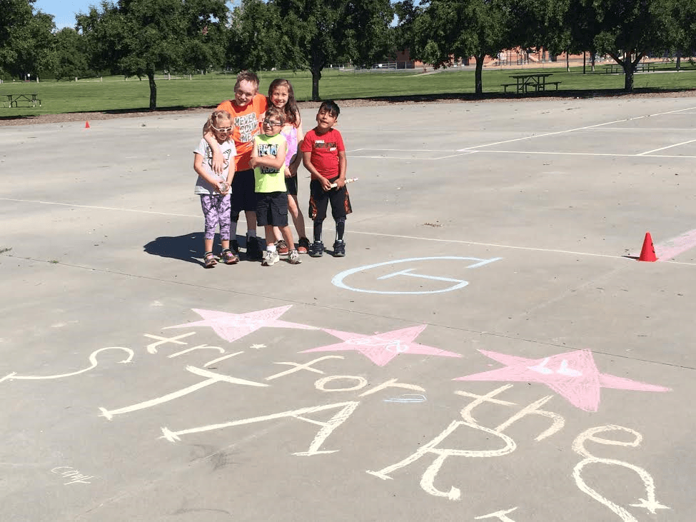 Group in front of stars chalk